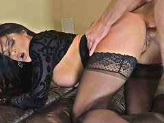 Fine And Wicked Brunette Lady On The Couch Seduces A Young Guy For Sex