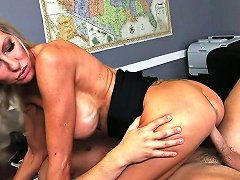 Sassy Tattooed MILF With Breast Implants Emma Starr Rides Seth Gamble's Cock